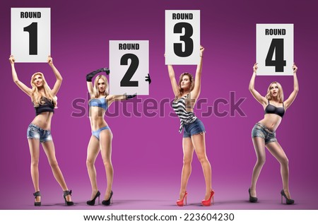 Boxing ring girls holding a board with round number. set. High resolution  - stock photo