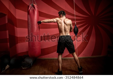 boxing training with professional athlete at the gym - stock photo