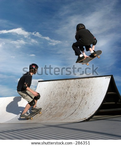 Boy and a girl skateboarding