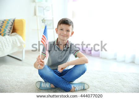 Boy and American flag in room - stock photo