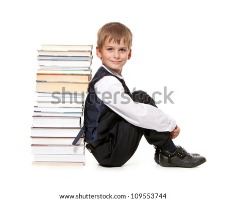 Boy and books isolated on a white background. Back to school - stock photo