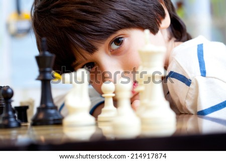 boy and chess, close-up, portrait - stock photo
