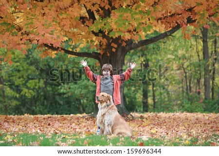 Boy and Dog in the Fall - stock photo