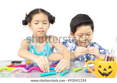 Boy and girl are happily playing clay toy