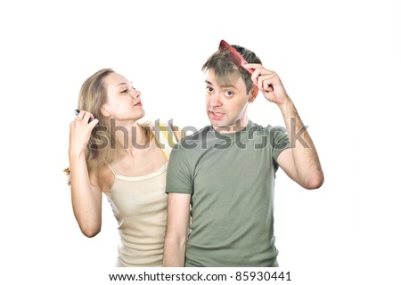 boy and girl are holding a comb, isolated over white