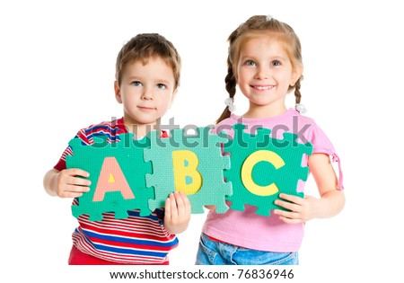 boy and girl are holding colorful letters