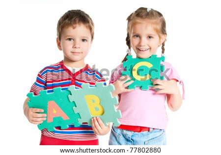 boy and girl are holding colorful letters - stock photo