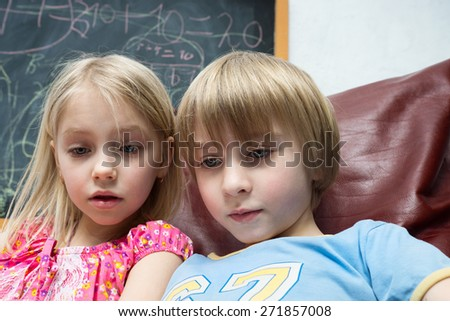 Boy and girl are reading - stock photo