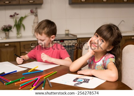 Boy and girl draw with pencils