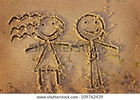 Boy and girl drawn in the sand/Sea background with a sand/Valentines day background