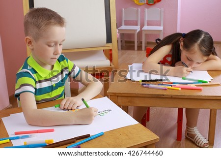 boy and girl draws a picture.