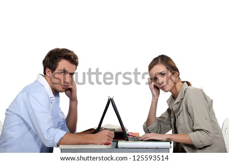 Boy and girl face to face with laptop computers - stock photo