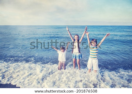 Boy and girl happy running at the  beach - stock photo