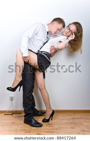 boy and girl having fun in the workplace, isolated over white