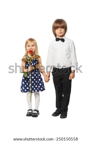 Boy and girl hold each other's hands on a white background - stock photo