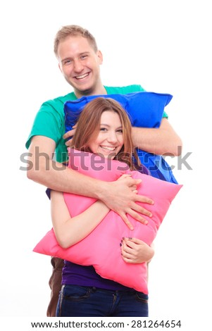 Boy and girl holding colorful pillows