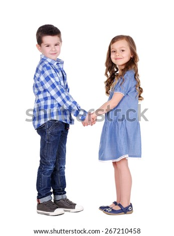 boy and girl  holding hands in hands - stock photo