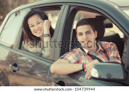 Boy and Girl in a Car Leaving for Vacation - stock photo