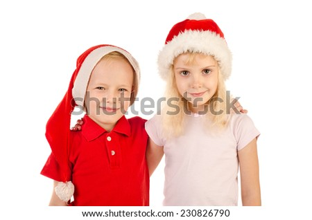 boy and girl in christmas hats