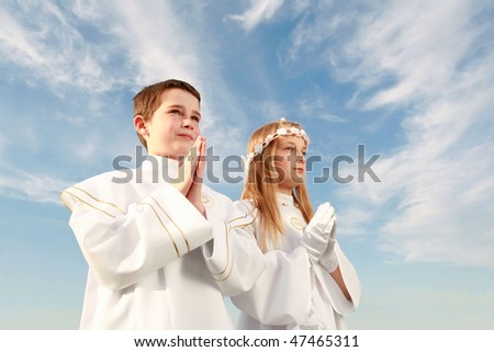 boy and girl in first holy communion, purity conscience, praying hands - stock photo