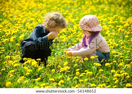 boy and girl in flowers - stock photo