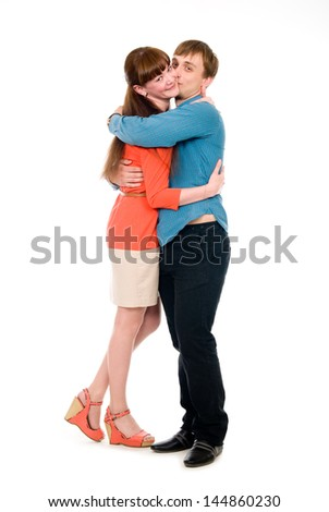 Boy and girl in love cuddling in full growth. Isolated on white background