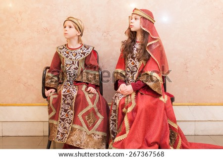 boy and girl in medieval costumes - stock photo