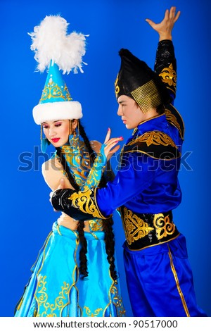 Boy and girl in the Kazakh national costumes