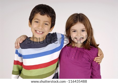 boy and girl isolated in white - stock photo