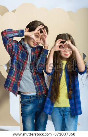 boy and girl laid her fingers hearts. Love concept - stock photo