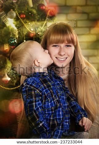 boy and girl near a Christmas tree - stock photo