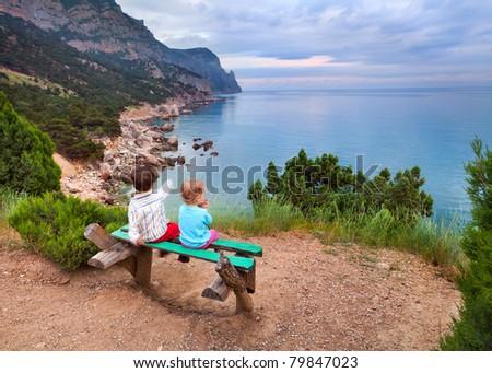 boy and girl on the beach - stock photo