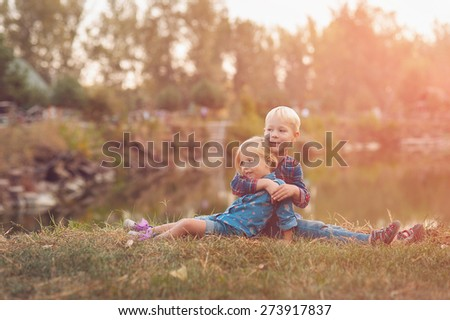 boy and girl on the nature sunset