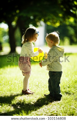 boy and girl playing with ball - stock photo