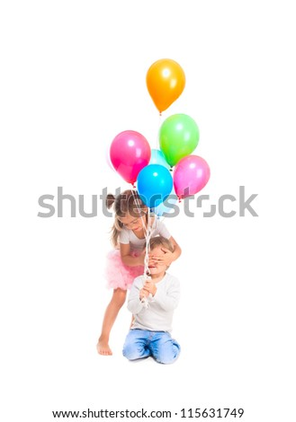 Boy and girl playing with balloons