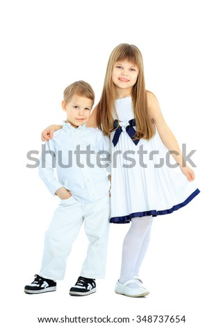 boy and girl posing on the camera - stock photo