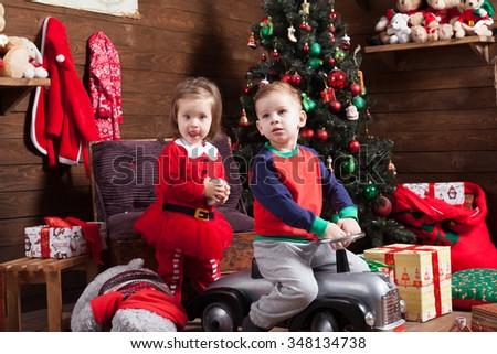 Boy and girl riding a tiny car - stock photo
