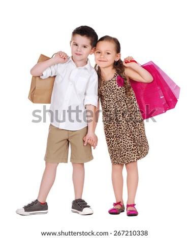 boy and girl shopping - stock photo