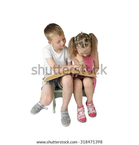 Boy and girl sit and read big book isolated on square white background - children education and knowledge