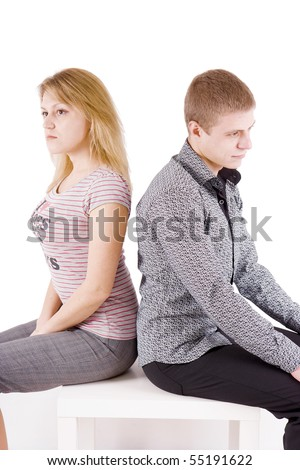 boy and girl sitting on a chair back to back