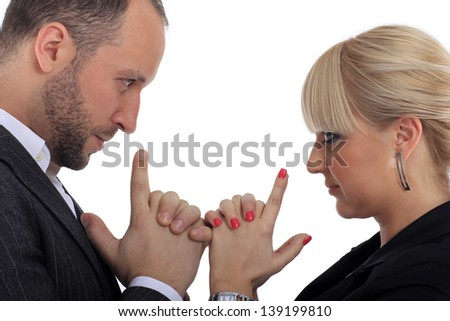 boy and girl stand facing each other and look at each straight in the eye and touching with fingers - stock photo