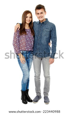 Boy and girl teenagers, friends, isolated on white background - stock photo