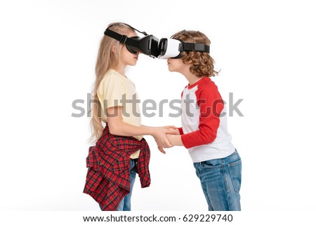 Boy and girl using virtual reality headsets isolated