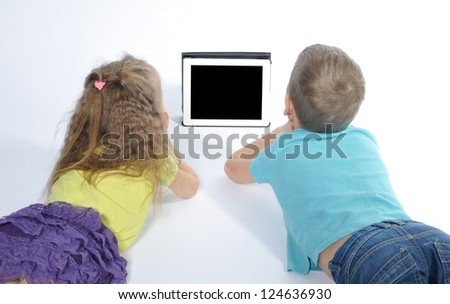 boy and girl watching digital tablet - stock photo