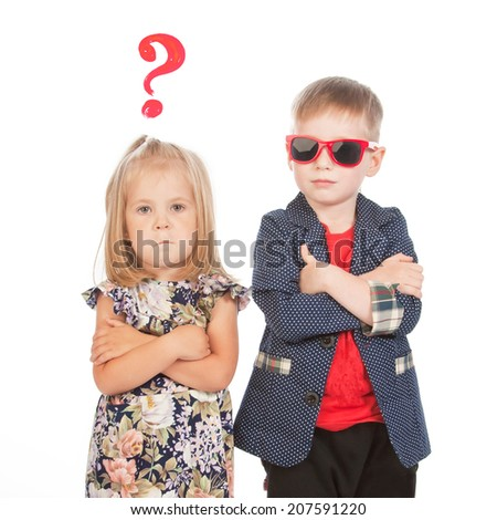 Boy and girl with arms across and a question sign, studio portrait - stock photo