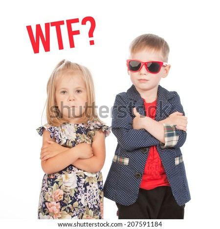 """Boy and girl with arms across and """"WTF?"""" text, studio portrait - stock photo"""
