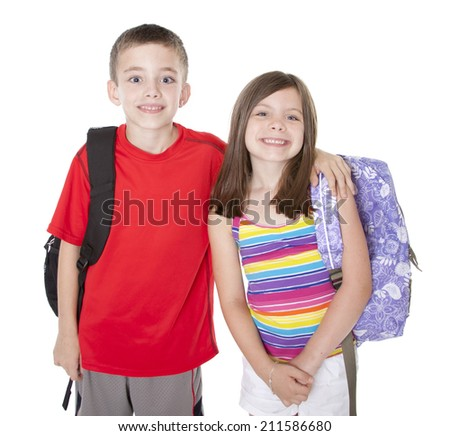 Boy and girl with backpacks isolated on white. - stock photo