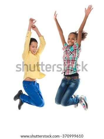 boy and girl with different complexion jumping isolated on white background - stock photo