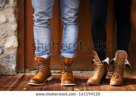 Boy and girl with fashion leather boots - stock photo