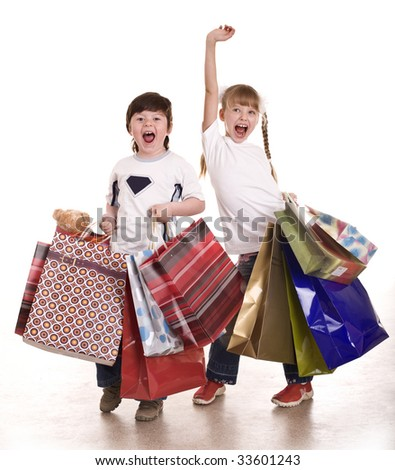 Boy and girl with shopping bag. Isolated. - stock photo